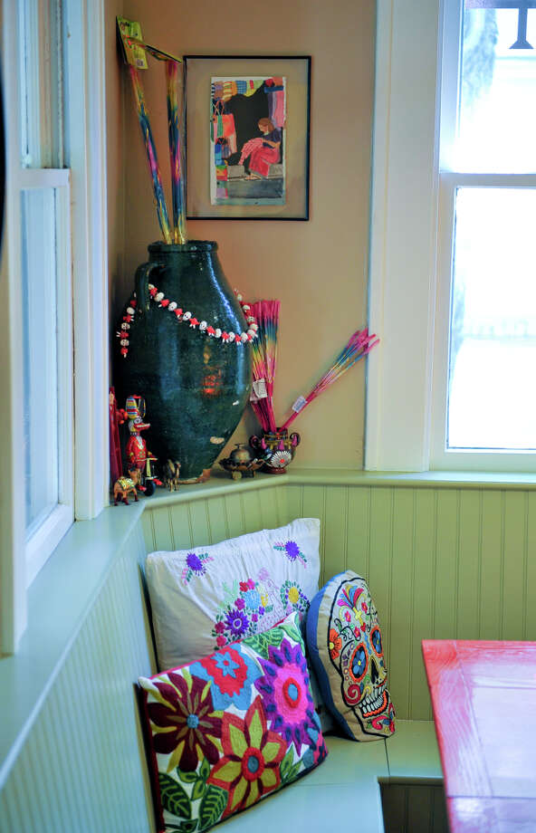 Ruthie Foultz included a banquette in her eat-in kitchen. It's a detail that might have been original in the Craftsman-style house, she said. Photo: Robin Jerstad, For The Express-News