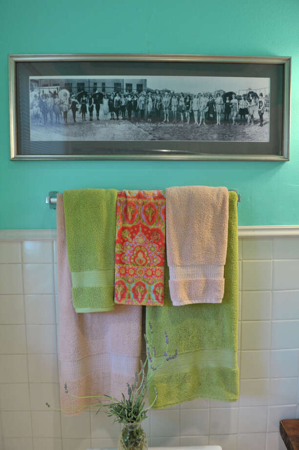 "Photos from E.O. Goldbeck's ""Bathing Beauties"" series hang in Ruthie Foultz's master bath. Photo: Robin Jerstad, For The Express-News"