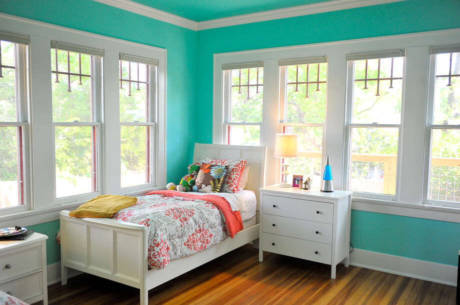 Light from windows floods the master bedroom, shared by Robin Foultz's two daughters. Photo: Robin Jerstad, For The Express-News