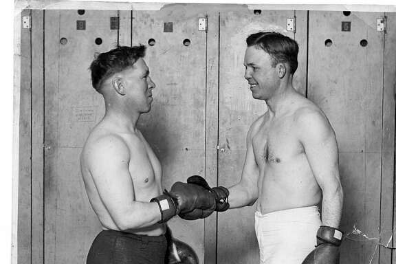 "Boxers ""Battling"" Nelson, right, and Dick Hyland shake hands before an exhibition round in Fresno, California on January 24, 1923."