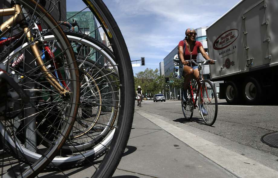 Bicyclists ride on Broadway at 20th Street in Oakland. A bill in the state Senate seeks to increase funding options for trails. Photo: Michael Macor, The Chronicle