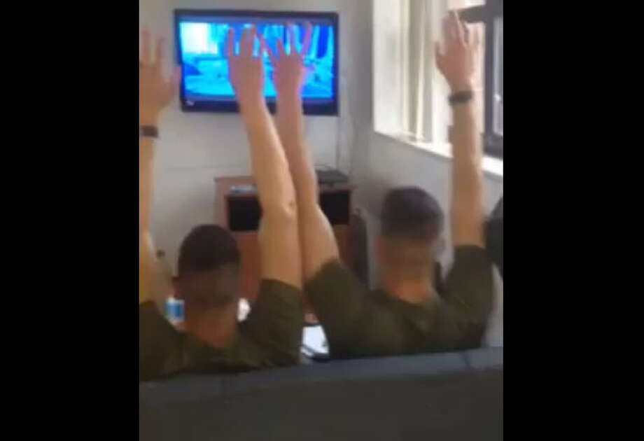 "The Marines from Bryan, Texas wave their ""spirit fingers"" in the air as they belt out the Disney classic Let it Go from Frozen."
