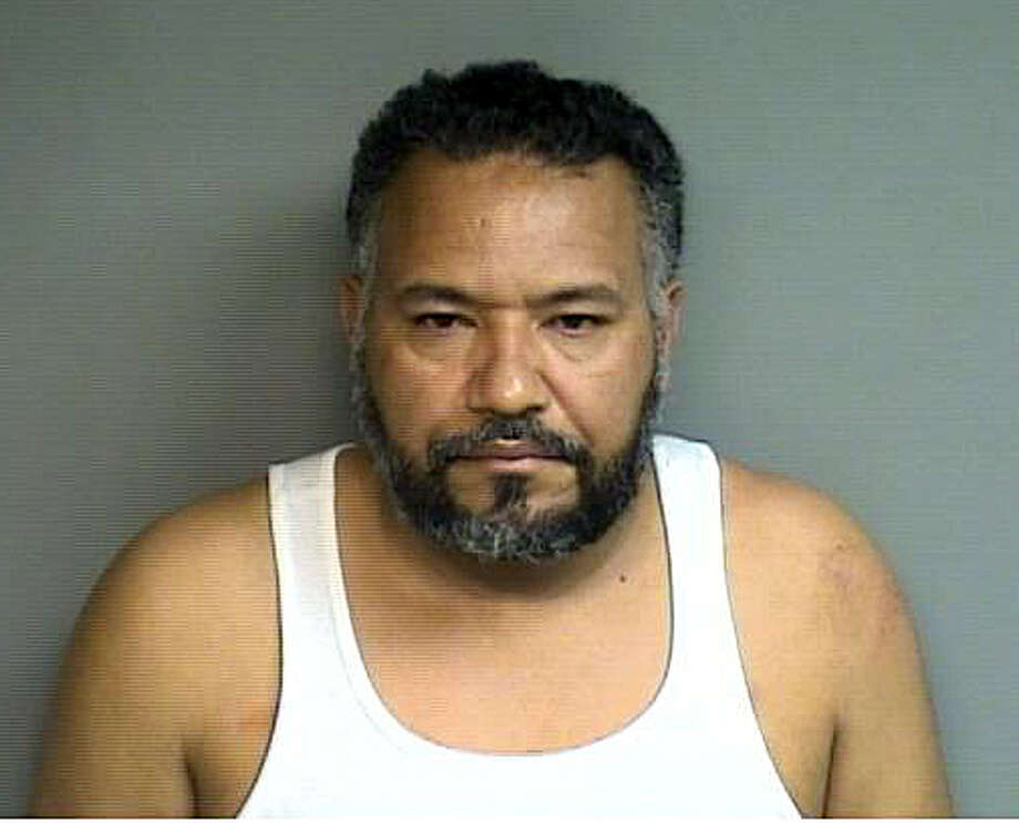 Jose Reynoso-Aleantara, 47, of New York City was arrested after he threw a quarter-pound bag of powdered cocaine that burst all over a stop sign on Cove Road in Stamford, Conn. Thursday May 1, 2014. Police recovered about 75 grams of the narcotic and used buckets of water to wash the unrecoverable cocaine out of street cracks nooks that it landed in. He was slapped with narcotics dealing charges and is being held in lieu of a $150,000 court appearance bond. Photo: Contributed Photo / Stamford Advocate Contributed