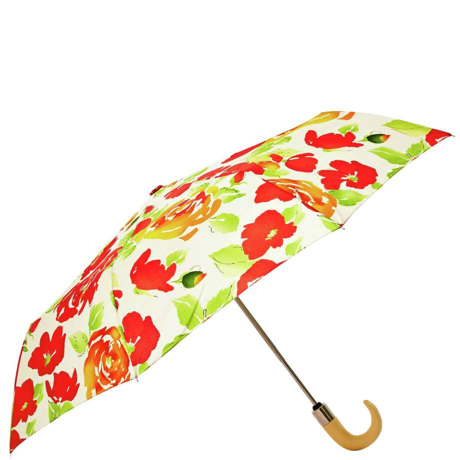 Dooney & Burke s new Rose Garden collection features a fresh floral print splashed on totes, handbags and accessories including a cheery umbrella; $58 at Dillard s and Macy s stores. Photo: Dooney & Bourke / Dooney & Bourke