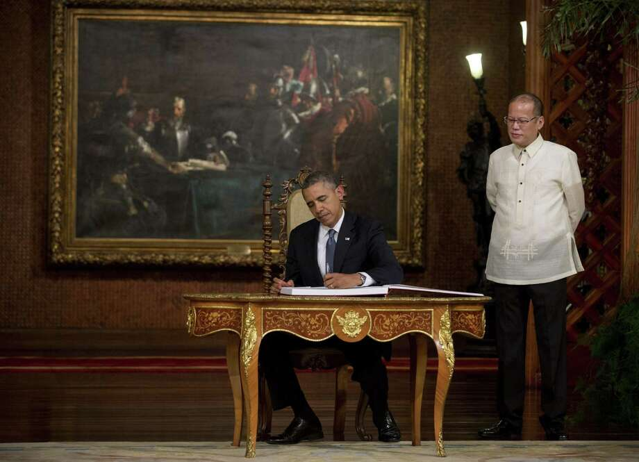 Another successful signing: President Barack Obama signs the official guestbook at Malacanang Palace in Manila on the last stop of his recent Asian trip. Obama's foreign policy is based on delusion. Photo: Stephen Crowley / New York Times / NYTNS
