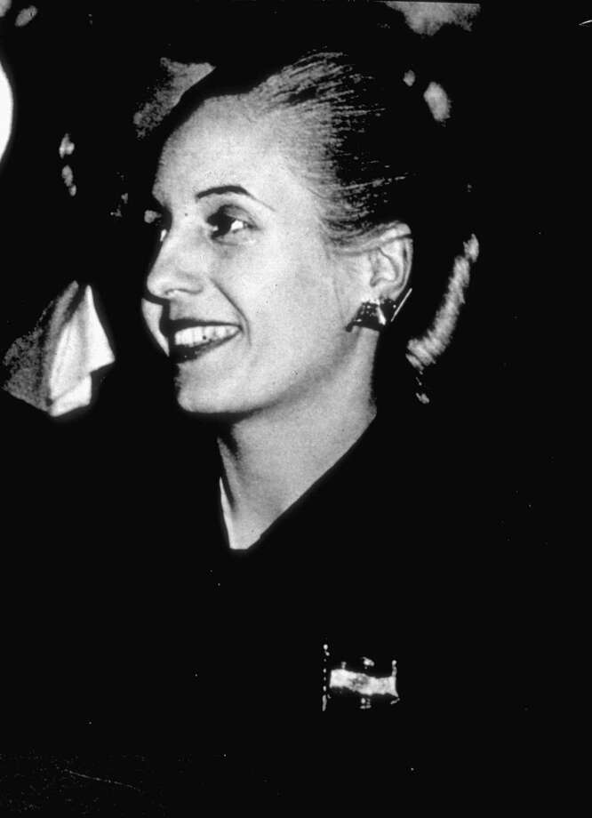 FILE-- Eva Peron wears a diamond brooch August 8, 1949, of the Argentine flag, which was commissioned for her in the early 1950's. Made by Van Cleef & Arpels, the pin will be auctioned  as part of Christie's  'Magnificent Jewels' sale April 6 and 7. (AP Photo/Archivo General de la Nacion Argentina) Photo: HO / ARCHIVO GENERAL NACION ARGENTINA