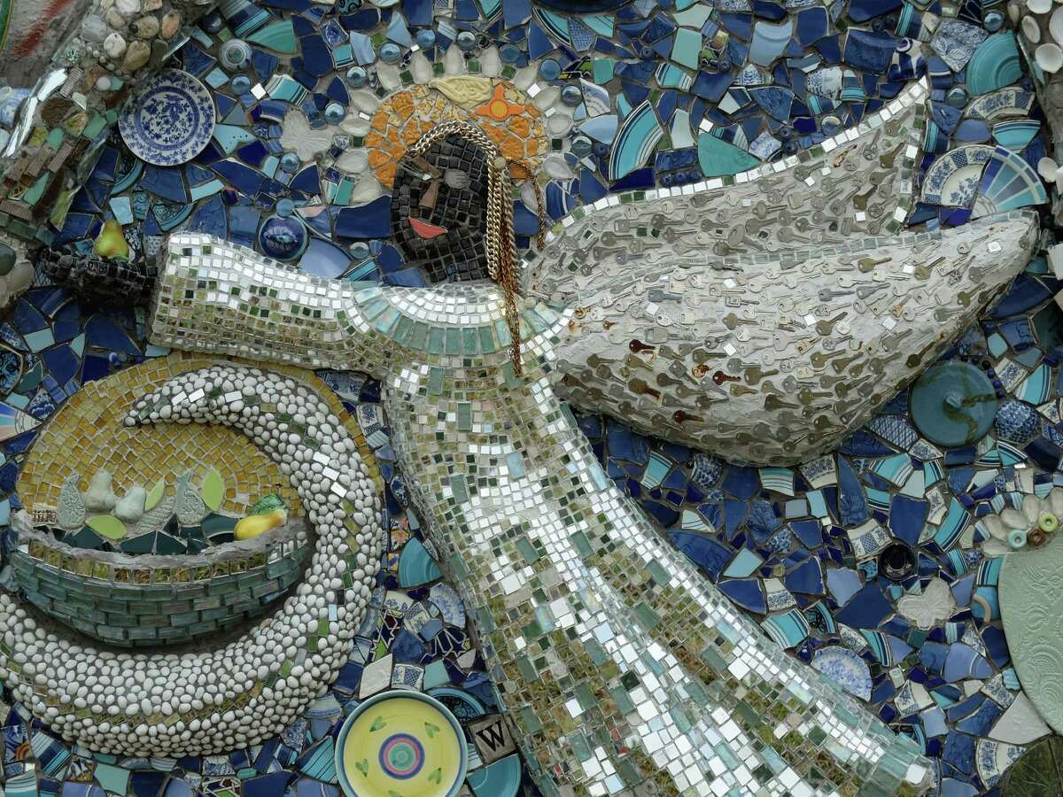 A detail of the mosaic wall being built at Smither Park adjacent to the Orange Show on Thursday, April 17, 2014. Dan Phillips designed the park's structures, all of which are being covered by local participants with tile, glass and other found materials.