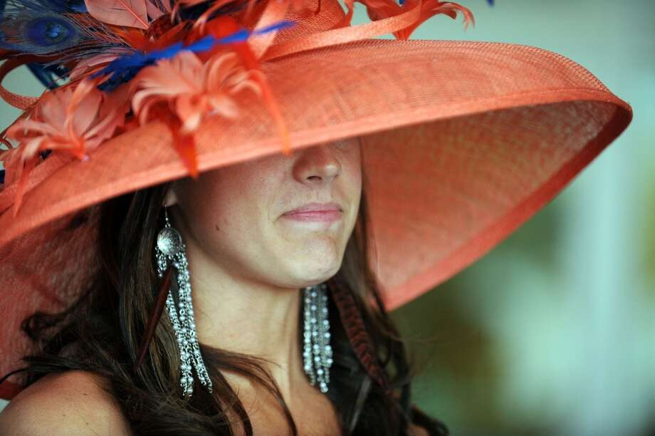 LOUISVILLE, KY - MAY 04:  A race fan wearing a festive hat attends the 139th running of the Kentucky Derby at Churchill Downs on May 4, 2013 in Louisville, Kentucky.  (Photo by Jamey Price/Getty Images) Photo: Jamey Price, Getty Images