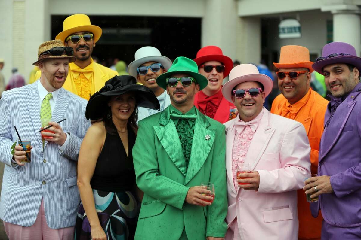 A group of fans in colorful hats and suits are seen in the paddock before the third race of the day at Churchill Downs Saturday, May 4, 2013, in Louisville, Ky. Today is the 139th running of the Kentucky Derby. (AP Photo/Gregory Payan)