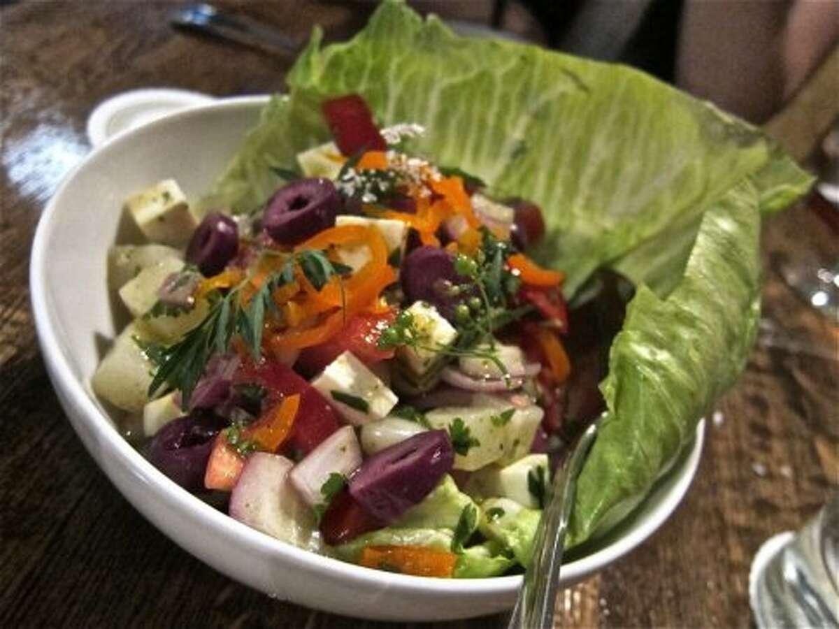 Solterito salad with choclo, aji amarillo and queso fresco in lemon vinaigrette, at Andes Cafe.