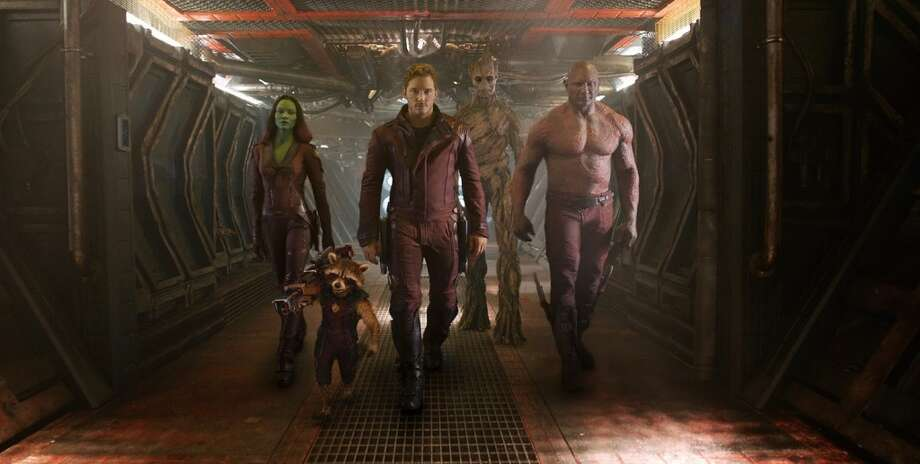 "GUARDIANS OF THE GALAXY (Aug. 1) - The big screen adaptation of X-Men's and The Avengers' lesser-known Marvel-mates could be an outer space-set train wreck (Bradley Cooper as the voice of a genetically-enhanced, gun-toting raccoon? Vin Diesel as a tree-man? Zoe Saldana playing a green alien instead of an ""Avatar"" blue one?) or it could be the new blockbuster franchise we didn't know we wanted (Bradley Cooper as the voice of a genetically-enhanced, gun-toting raccoon! Vin Diesel as a tree-man! Zoe Saldana playing a green alien instead of an ""Avatar"" blue one!)."