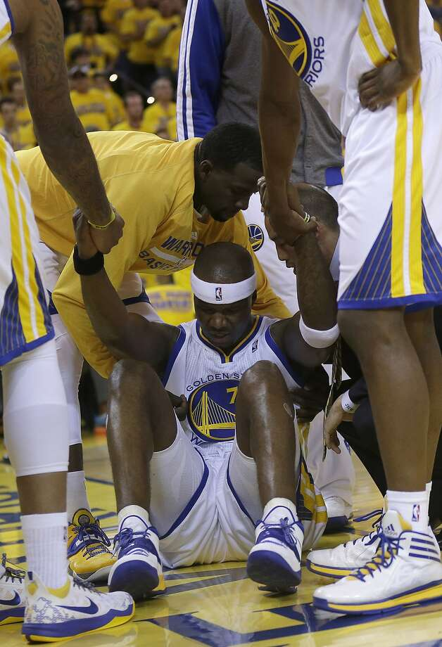 Jermaine O'Neal is helped to his feet after the Clippers' Glen Davis barreled into him in Game 6. Photo: Marcio Jose Sanchez, Associated Press