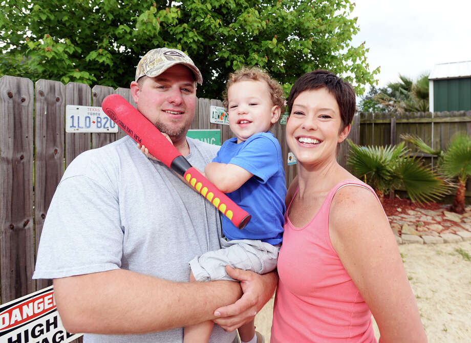 The Tate family -- Jarod, William, 1, and Jennifer -- pose for a picture in their backyard Thursday afternoon. After her husband Jarod caught a funny moment between Jennifer Tate and her son William, 1, on camera, the family sent the clip into America's Funniest Home Videos. The video will air Sunday night.  Photo taken Thursday, 5/1/14 Jake Daniels/@JakeD_in_SETX Photo: Jake Daniels / ©2014 The Beaumont Enterprise/Jake Daniels