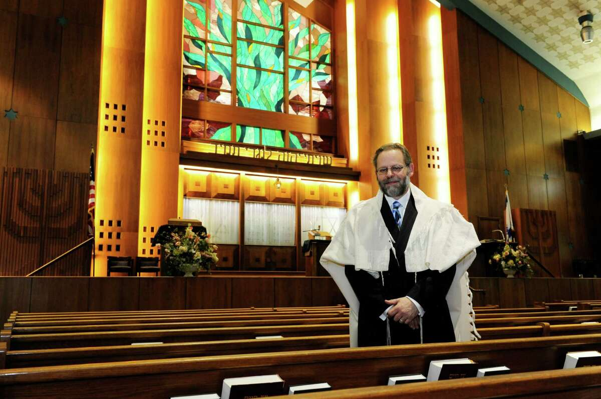 Rabbi David Eligberg, shown in the sanctuary at Temple Israel in Albany, will supervise food production for TI Takeout, the temple's ongoing partnership with The Iron Works restaurant in Troy for kosher holiday fare for Jewish holidays.