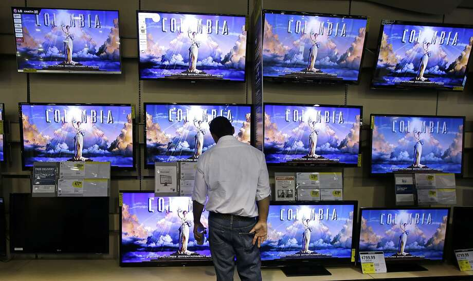 Demo televisions often are set to display exceedingly vivid pictures in order to impress shoppers, outshine other TVs and combat bright store lights. Photo: Mark Humphrey, Associated Press