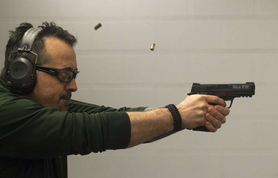 Athena Gun Club is a great place to blow off some steam after a hard day at the convention. Since OTC is during the week, the waits during the day and evening to get a shooting lane shouldn't be so bad. Photo: J. Patric Schneider, For The Chronicle