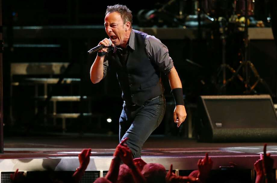 Bruce Springsteen and the E Street Band perform at the Cynthia Woods Mitchell Pavilion on Tuesday night in The Woodlands. The venue is near where the new Exxon Mobil corporate campus will be. Photo: Mark Metcalfe, Getty Images