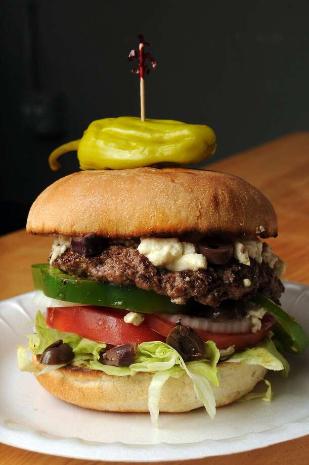 The Greek burger at the Hubcap Grill on Prairie is worth driving into downtown for, though there might be a weight, er, wait. Photo: Dave Rossman, For The Chronicle
