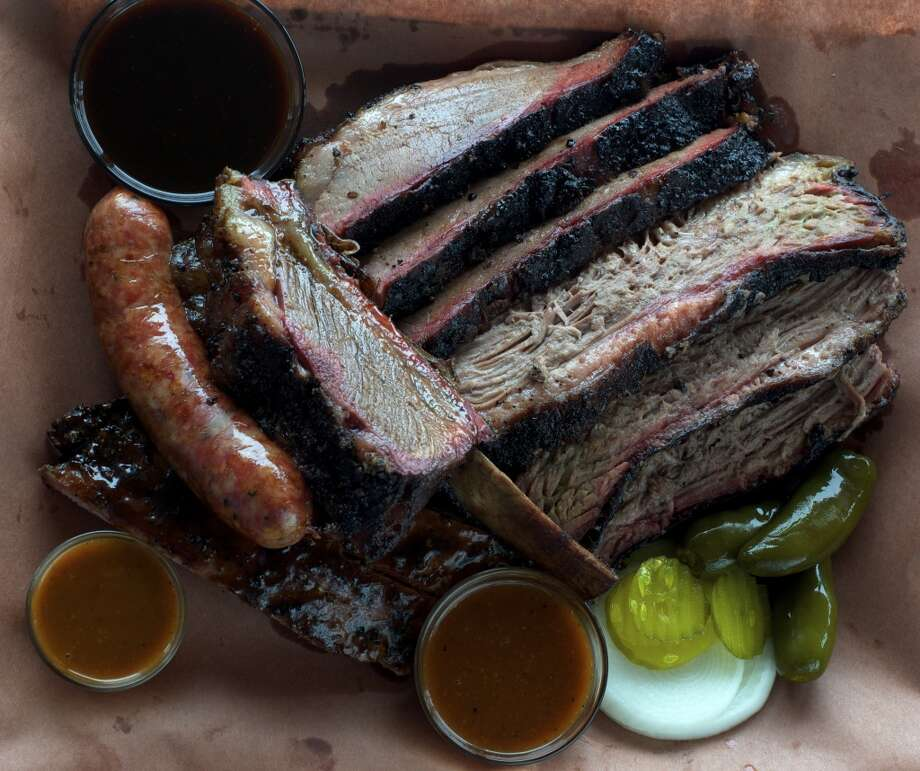 Brisket, sausage and beef ribs as served at Killen's Barbecue in Pearland. This is worth leaving NRG Park for a few hours for. Bring some brisket back for your boss. You may get a raise. Photo: Kimberley Park, Killen's Barbecue
