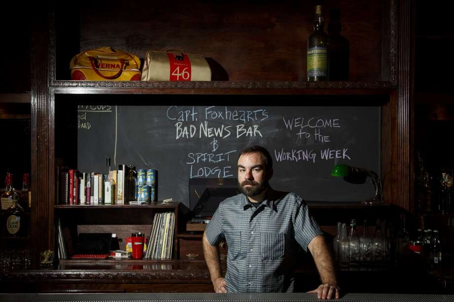 Bartender and owner Justin Burrow poses for a portrait at Captain Foxheart's Bad News Bar & Spirit Lodge, This bar has an excellent patio overlooking Main St., perfect for conversation and stogies. Photo: Michael Paulsen, Houston Chronicle