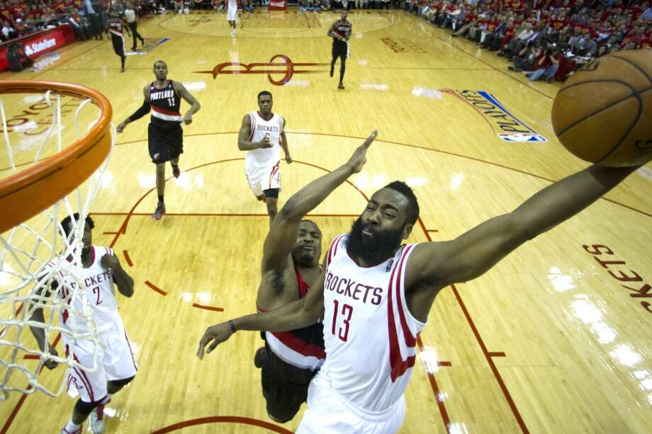 Here's hoping the Rockets best the Portland Trailblazers so you can catch a playoff game. Photo: Brett Coomer, Houston Chronicle