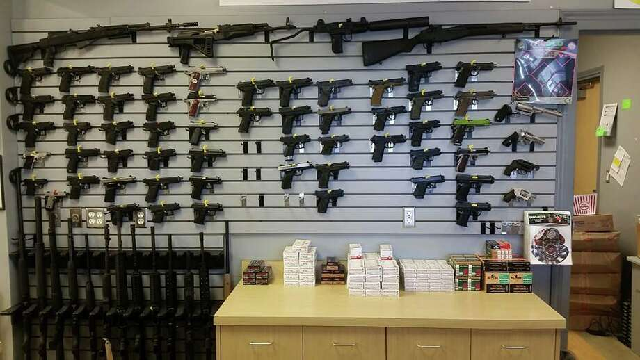 The Arms Room in League City will let you shoot any weapon in this wall for a $25 rental fee. You have to pay for the ammo though.