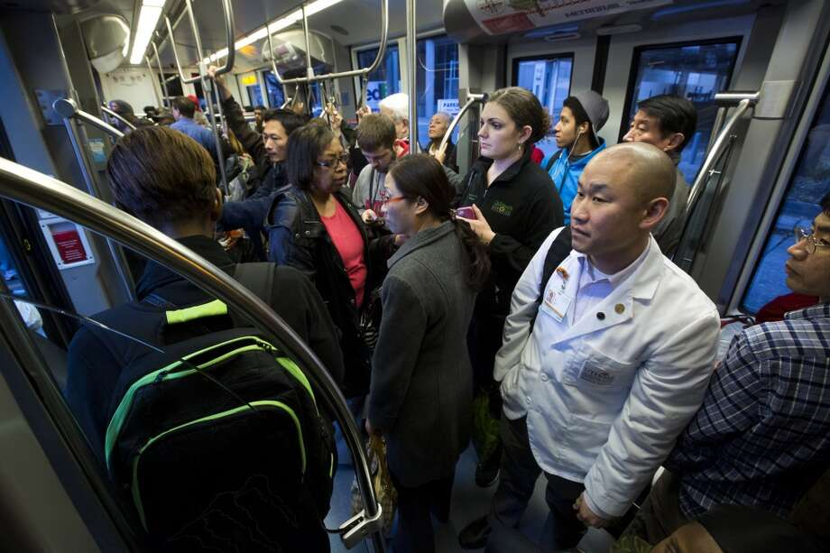 Use the METRORail for destinations off Main St. while in Houston. Don't worry, it's not always this packed. Photo: Marie D. De Jesus, Houston Chronicle