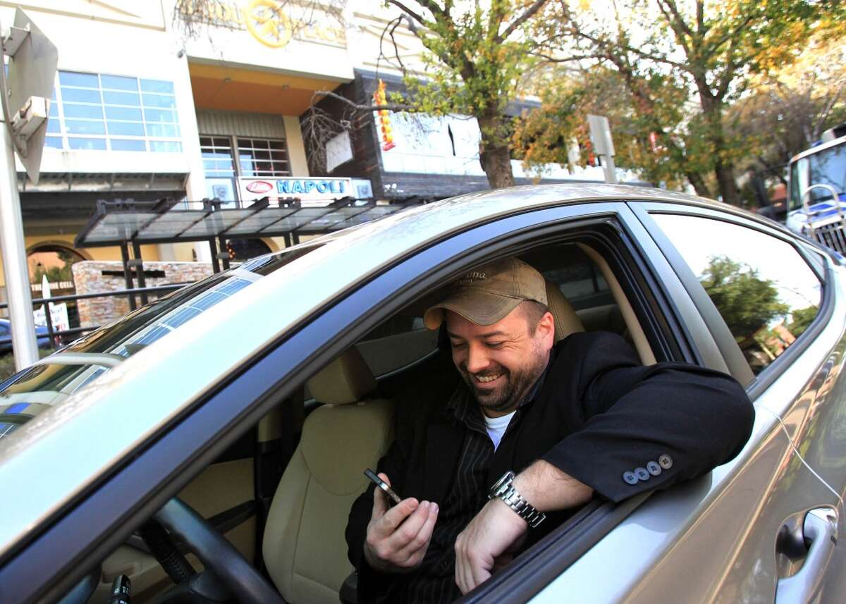 Uber driver Brian Walts waits for a fare on Friday, Feb. 21, 2014, in Houston.( Mayra Beltran / Houston Chronicle )