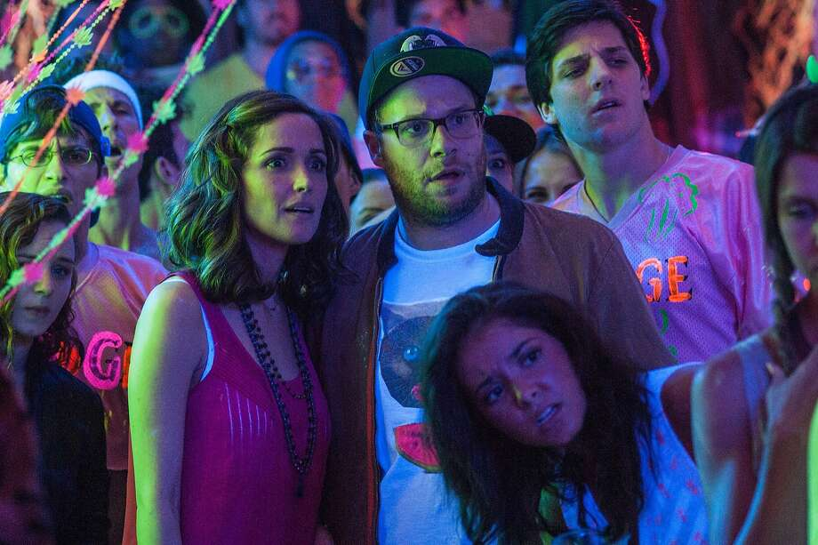 "Kelly (Rose Byrne) and Mac (Seth Rogen) must deal with the fallout and the pratfalls when a fraternity moves in next door in the new Universal Pictures comedy ""Neighbors."" Photo: Glen Wilson, Associated Press"