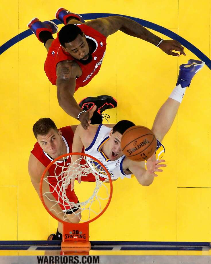 Klay Thompson, the Warriors' second-leading scorer at 16.7 points per game in the first-round series against the Clippers, puts up a shot against Los Angeles' Blake Griffin and DeAndre Jordan (top). Photo: Carlos Avila Gonzalez, The Chronicle