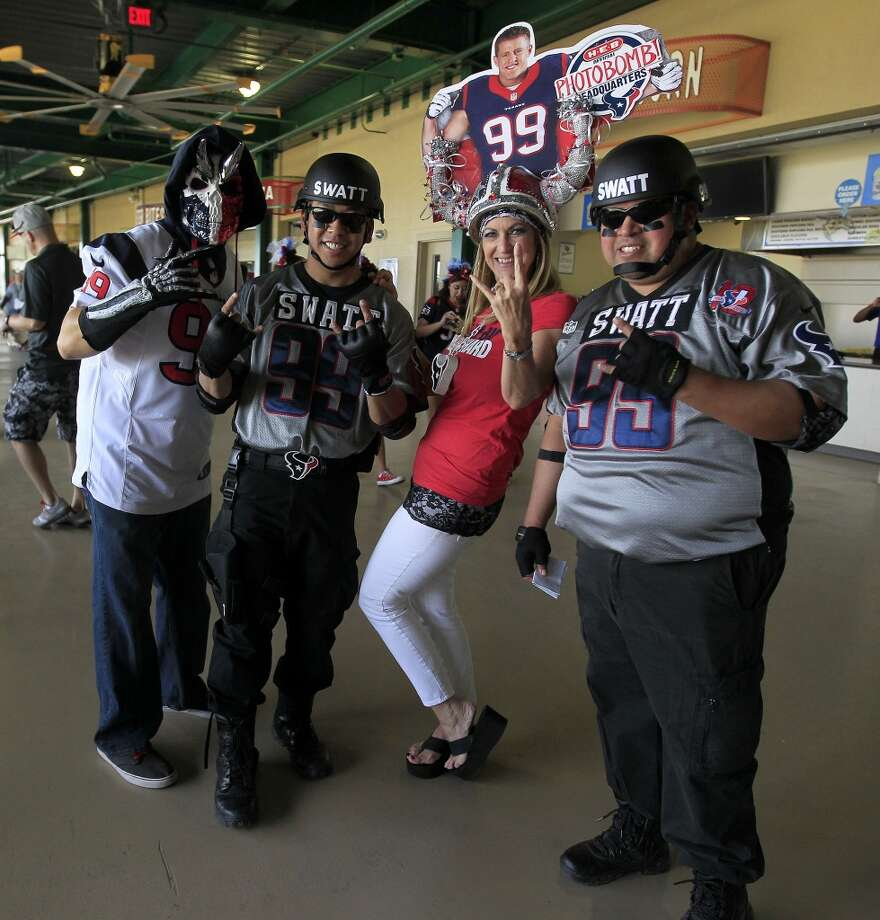 "Fans Toro ""Two point O"", Jeff Khong, Pati Cream, and Izzy Vences pose for photos before the start of the J.J. Watt 2014 Charity Classic at Constellation Field on Friday. Photo: Karen Warren, Houston Chronicle"