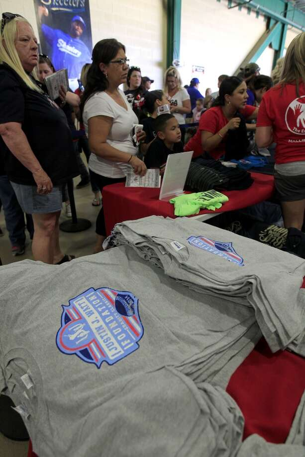 Fans stand in line for J.J. Watt merchandise before the start of the game. Photo: Karen Warren, Houston Chronicle