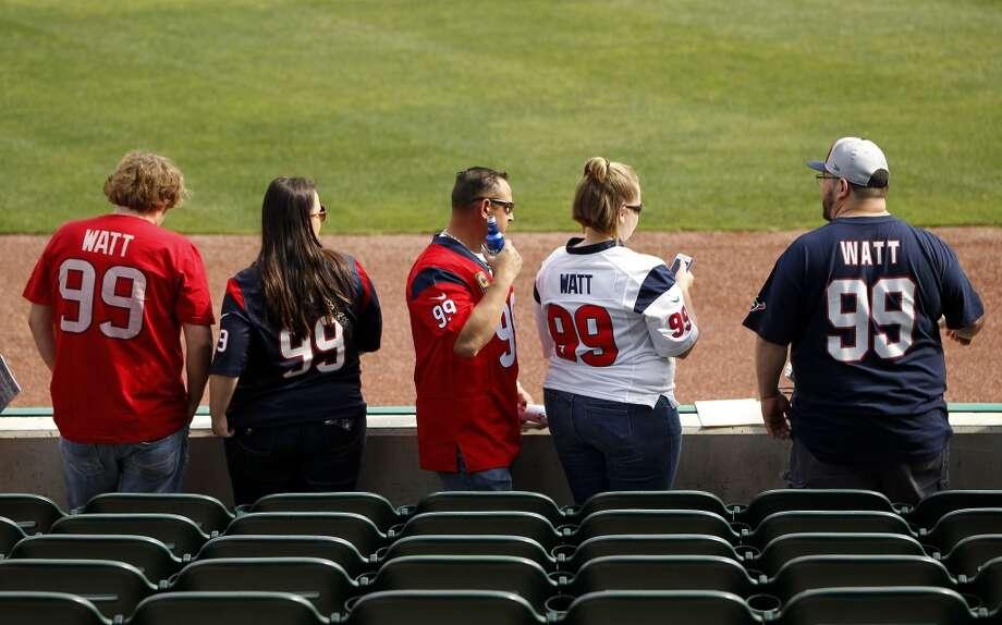Fans line up wearing J.J. Watt jerseys along the third base line before the start of the game. Photo: Karen Warren, Houston Chronicle