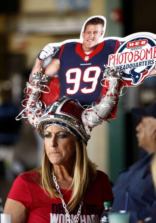 Pati Cream, of Pasadena wears a J.J. Watt helmet before the start of the game. Photo: Karen Warren, Houston Chronicle
