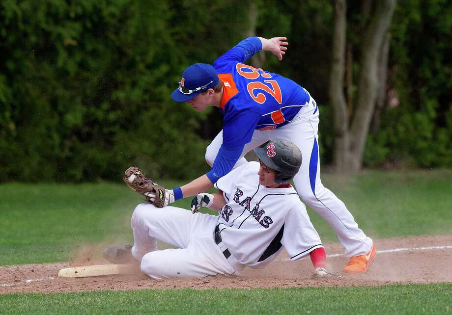 Danbury's Dan Clancy gets New Canaan's Brandon Abate out at third base during Friday's baseball game at Mead Park in New Canaan, Conn., on May 2, 2014. Photo: Lindsay Perry / Stamford Advocate