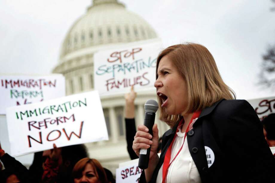 Immigration reform activists hold a rally in Washington earlier this year. A poll indicates most Texas voters of every political stripe think the nation's immigration laws are not working. Photo: Alex Wong, Staff / 2014 Getty Images