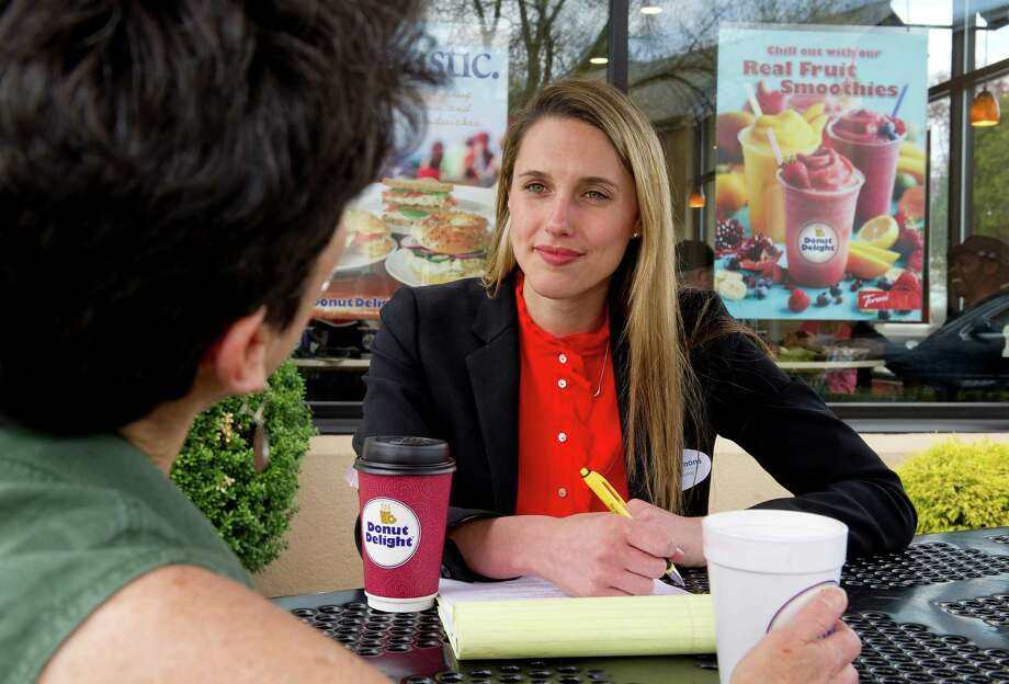 Caroline Simmons speaks with Kate Heichler at Donut Delight in Stamford, Conn., on Friday, May 2, 2014. Simmons is running for the Democratic nomination for State Representative in District 144. Photo: Lindsay Perry / Stamford Advocate