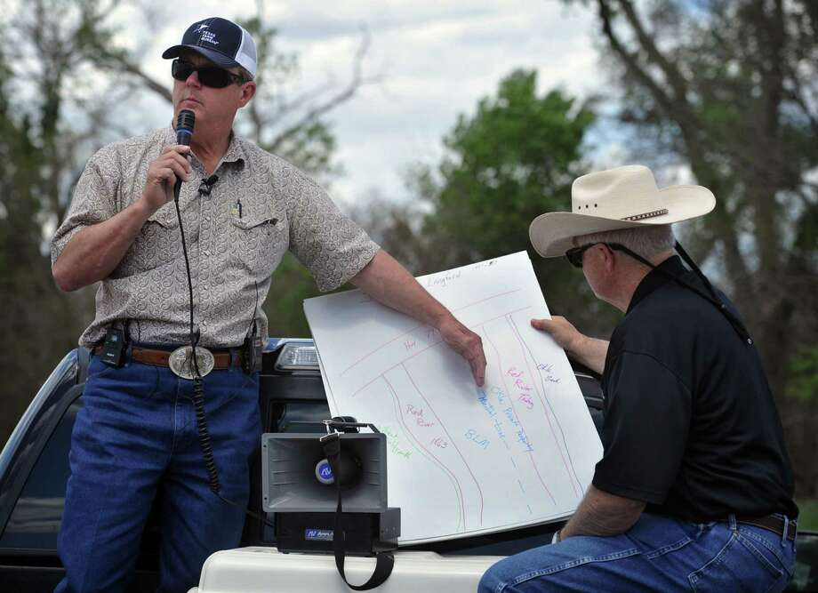 Tommy Henderson, left, a landowner with property along the Red River north of Byers, Texas spoke Monday afternoon about a dispute with the Bureau of Land Management and several land owners. The landowners say they have clear and proper deeds to their property. Henderson owned 386 acres according to his original deed, but lost 140 acres to the federal government in a 1984 federal court case in Oklahoma. The dispute is complicated by whether the land extendes to the Red River banks, the vegetation line or a medial line determined by the river's flow, which changes over time.  (AP Photo/Wichita Falls Times Record News, Torin Halsey) Photo: Torin Halsey, MBI / Wichita Falls Times Record News