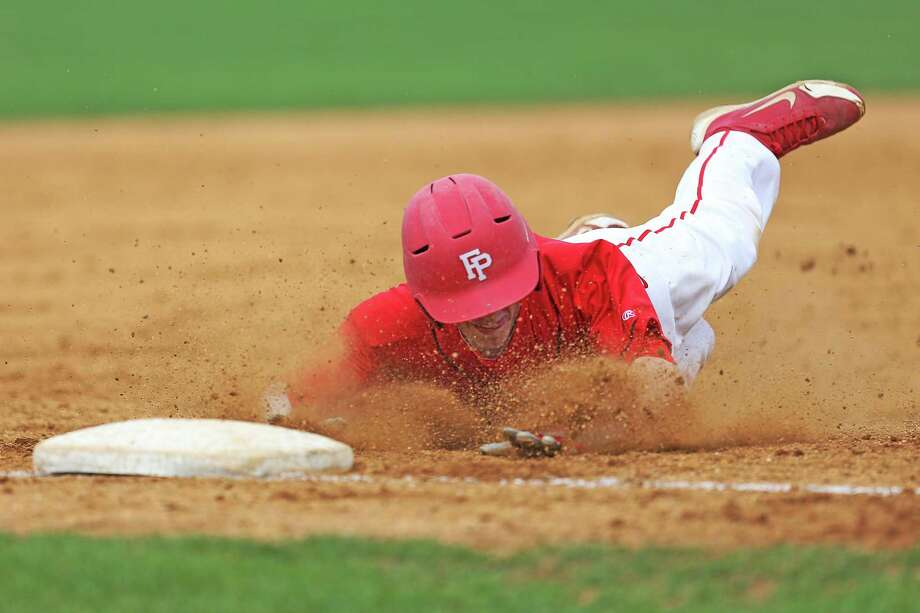 Fairfield Prep's #14 Matt Beck steals third base during Friday afternoon match-up against Amity High School. Prep would win 10-7. Photo: Mike Ross / Mike Ross Connecticut Post freelance - @www.mikerossphoto.com