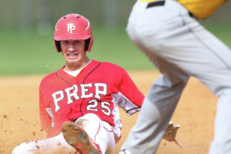 Fairfield Prep's #25 Kevin Stone makes a safe slide into third base on a steal during Friday afternoon match-up against Amity High School. Prep would win 10-7. Photo: Mike Ross / Mike Ross Connecticut Post freelance - @www.mikerossphoto.com
