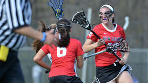 New Canaan's Samantha Stewart (18) on the field during the girls lacrosse game against Darien High School at Darien High School on Friday, May 2, 2014.