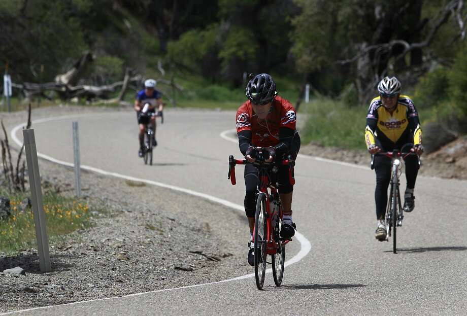 Bicyclists climb a curvy section of Mines Road near the halfway point of the Devil Mountain Double Century ride in Livermore, Calif. on Saturday, April 26, 2014. The 206-mile route includes climbs to the peaks of both Mount Diablo and Mount Hamilton. Photo: Paul Chinn, The Chronicle