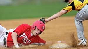 Fairfield Prep's #23 Joe Ganim slides safe against the tag from Amity High School's third baseman  #25 Matthew Ronai during Friday afternoon match-up. Prep would win 10-7.