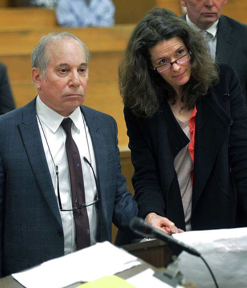 Singer Paul Simon, left, holds hands with his wife Edie Brickell at a hearing in Norwalk Superior Court on Monday April 28, 2014 in Norwalk, Conn. The couple were arrested Saturday on disorderly conduct charges by officers investigating a family dispute at their home in New Canaan, Conn. Photo: AP Photo/The Hour, Pool Photo/Alex Von Kleydorff / Associated Press
