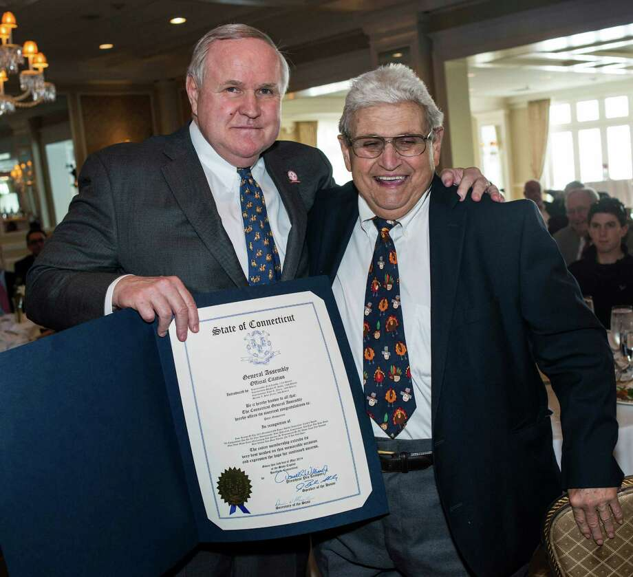 left to right: Selectman, David Theis, presents Peter Gasparino with a proclamation during the Greenwich Old Timers Athletic Association luncheon to honor Peter Gasparino as this yearâÄôs recipient of the fifth annual CoachâÄôs Lifetime Achievement Award the event was held at the Greenwich Country Club, Greenwich, CT on Friday, May, 2nd, 2014. Photo: Mark Conrad / Connecticut Post Freelance