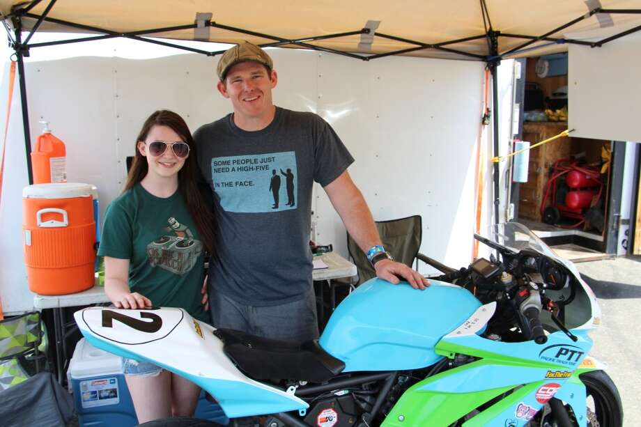Valentine Welch and her father, Mike, with her Kawasaki Ninja 250. Valentine has been racing for eight years. She is now 16.