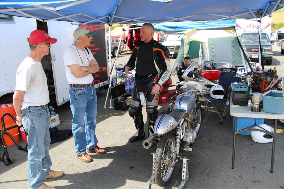 Jensen and a couple of visitors chat about his and their motorcycles.