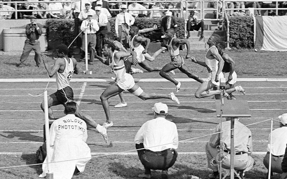 Frank Budd (left), breaks the tape to win the 100-yard dash at the 1961 National AAU track and field championships. Photo: Associated Press File Photos / AP