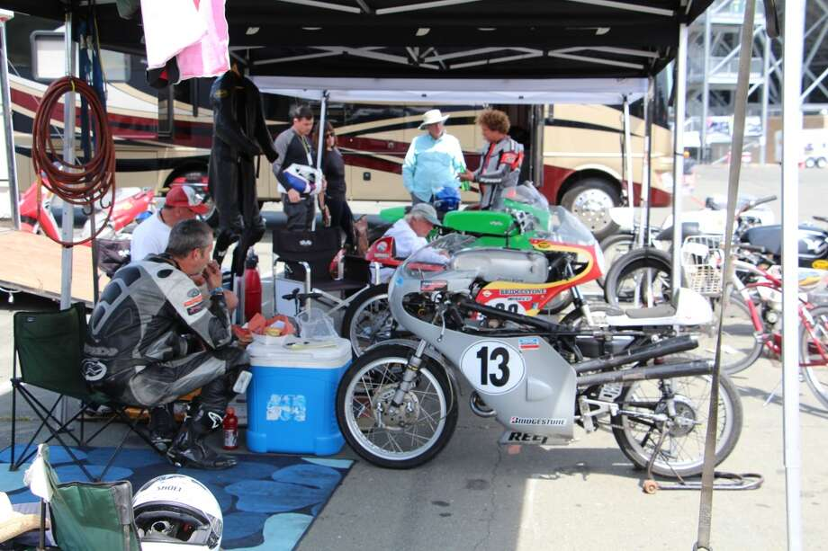 Racers gather under a canopy to rest between races.