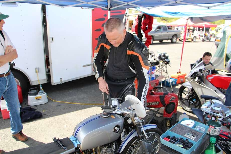 Neil Jensen works on his Honda CL175.